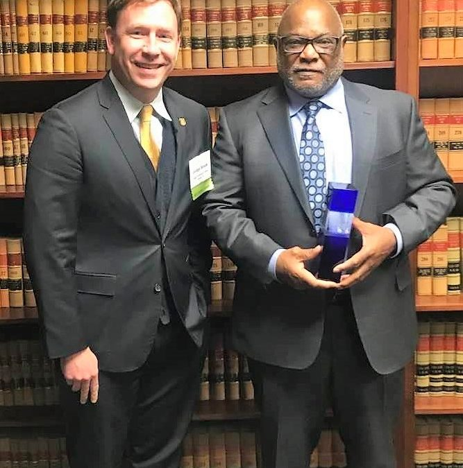 NC CRED Board Chair James Williams receives the prestigious James McNeill Smith Jr. Award